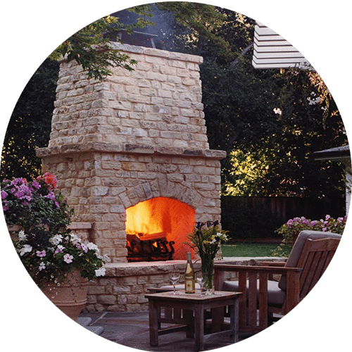 Stone Fireplace Next To The Outdoor Kitchen And A Lovely: Custom Fireplace Builder Houston